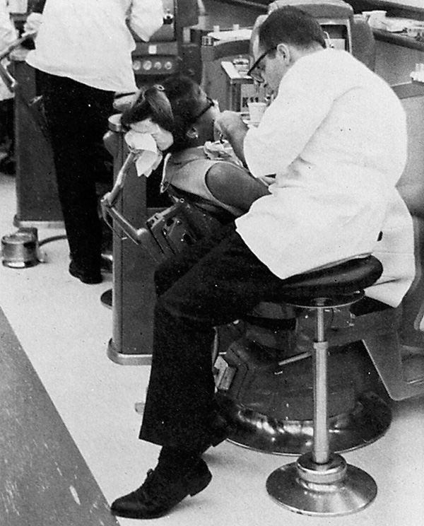 archived photo of early dental sitting techniques